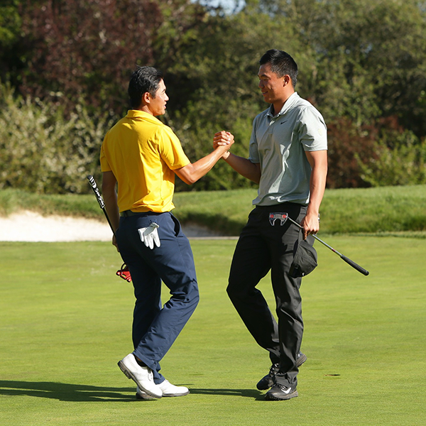 photo of Cal's Collin Morikawa and Oregon's Norman Xiong after 2018 playoff