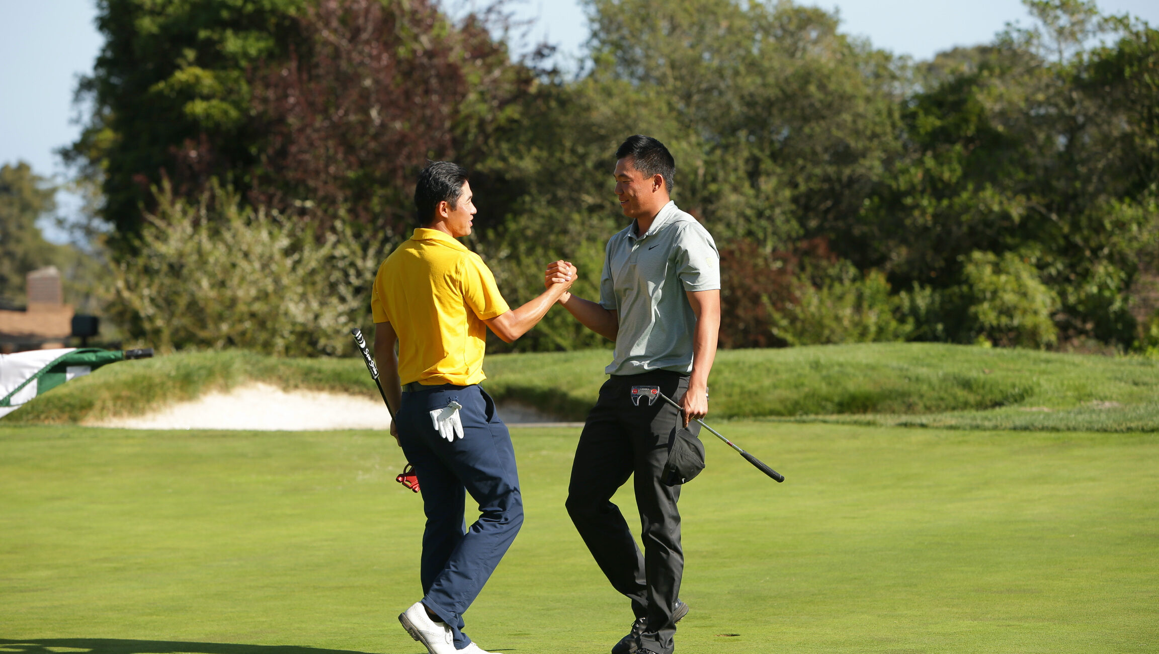 Cal's Collin Morikawa congratulates Oregon's Norman Xiong for winning the 3-player playoff